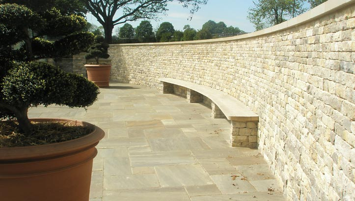Dry Stone Waller |  Retained, cladded curved wall & freestanding pillars